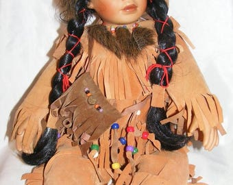 Native American Style Sitting Porcelain Doll Dressed in Native Style Shirt & Pants