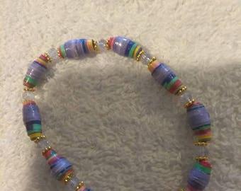 Handmade bracelet out of handmade paper beads.