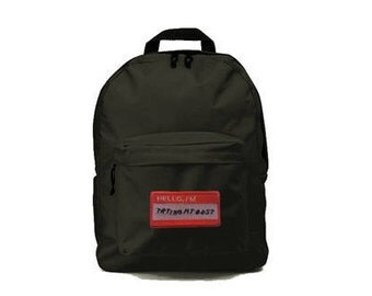 Black backpack with 'Hello I'm trying my best' patch 33x41x19cm
