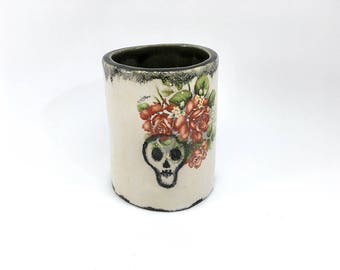 Ceramic desk organizer with a skull and flower pattern
