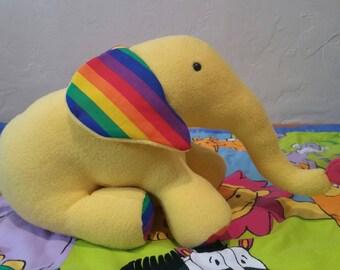 Elephant stuffed animal toy in yellow and rainbow fabric
