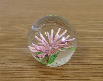 Vintage Small Pink Spiky Flower Glass Paperweight with a Lovely Striking Pink Flower. No name but a lovely item in good condition.