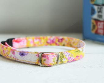 Floral Cat Collar Yellow - safety clip. Bright yellow cat collar with purple and pink flowers, quick release and metal fittings.
