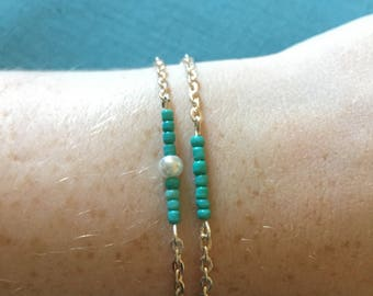 Simple silver chain and turquoise seed beads/pearl bracelet with heart toggle clasp