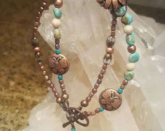 Copper sunflower button bracelet with real turquoise and Sunstone beads. Copper African beads and glass ovals tipped in copper. Size 7