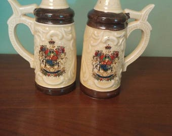 Vintage salt and pepper stein shakers. Japan