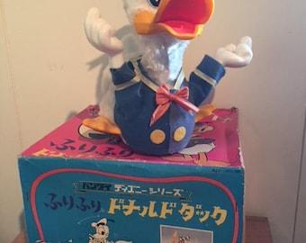 Vintage Walt Disney Donald Duck mechanical toy with original Box.