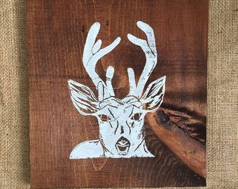 Woodland theme animal prints on stained wood