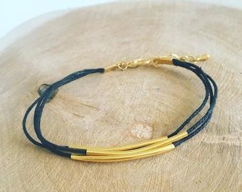 """""""Golden Tube"""" waxed cord bracelet"""