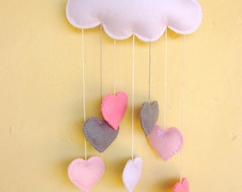 White felt cloud nursery mobile with a cascade of baby pink, bubble gum pink and grey hearts ..can be personalised