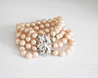 Vintage pink pearl bracelet band, rhinestone buckle closure
