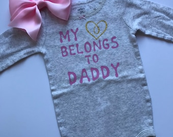 Baby Girl Onesie with a Pink Bow Headband