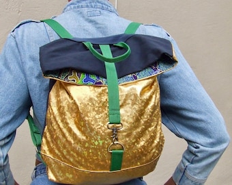 gold and canvas vegan leather back pack