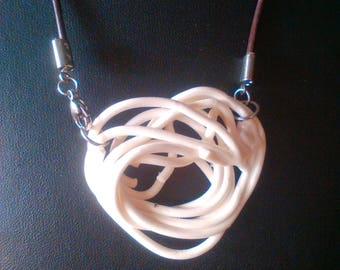Porcelain heart, porcelain in enamelled rods with steel clasp and leather