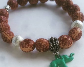 12mm Etched Wood Beads with Teal Elephant Charm