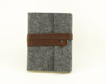 Notebook for wrapping of grey wool felt and brown leather strap