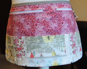 Victorian print vendor apron with red/pink/white floral print background