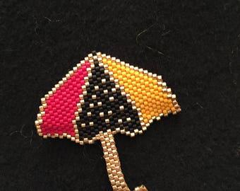 Black Miyuki umbrella brooch