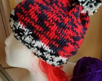 Red, black and white hat with pompon, red, black and white cap with Pompon.