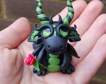 Polymer clay Dragon, black and green twist, red rose.