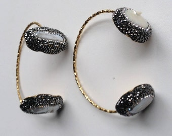 Brass bangles with mother of pears
