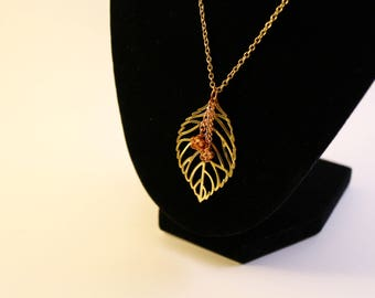 rose and gold tone dimension necklace
