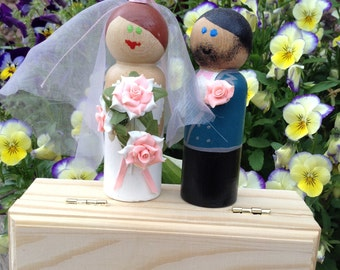Wedding Couple, cake toppers and keepsakes.