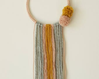 Dream catcher in wool with pastel colors tassels
