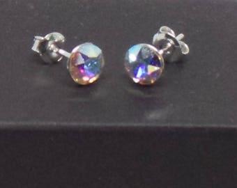 Sterling Silver stud earrings featuring Swarovski Crystal.