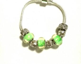 European bracelet with iridescent Green European beads