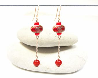 Red long earrings dangling
