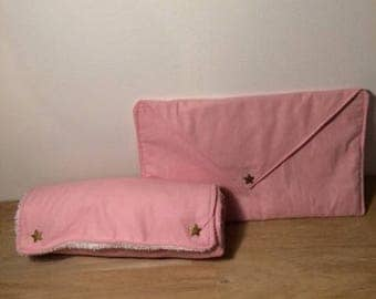 Changing pad mobile with a pink diaper pouch