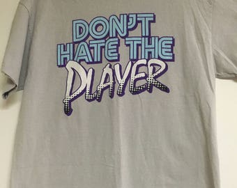 "vintage 90's T-Shirt. ""Don't hate the player."""