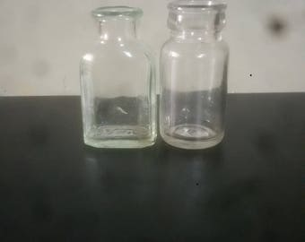 2 antique glass jars
