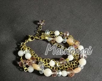 Gilded steel bracelet with powdered jade and peach Agate