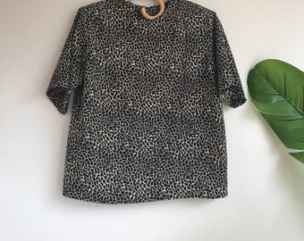 Vintage Black and White Silky Short Sleeve Blouse Size 8 petite Animal Print