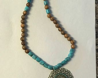 Turquoise and olivewood necklaces with pendant