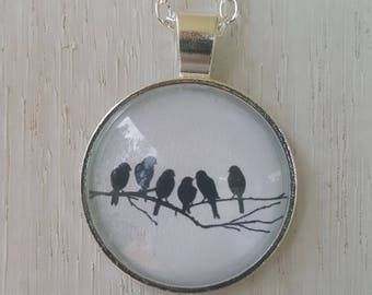 Birds on a wire glass pendant on silver necklace