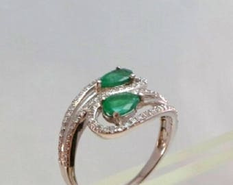 White Gold bypass Ring with two pear shape Emerald