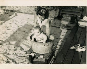 vintage photo 1948 Baby gets bath in A Bucket Mom holds Her