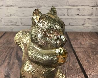 Silver Squirrel Bank Holding a Golden Acorn