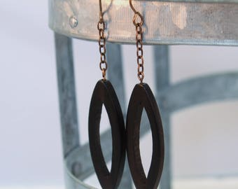 Ebony wood Philippines ellipse dramatic long natural brass earrings by CURRIUCLUM