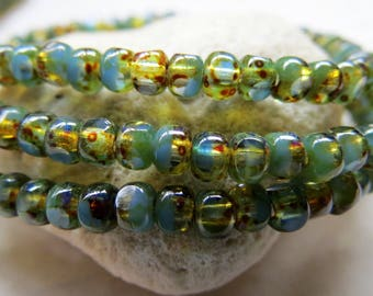 NEW SWIRLED BLUE .  Czech Tri cut Picasso Seed Beads . size 6/0 . (50 beads)