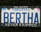 Grateful Dead, The Music Never Stopped License Plate Frame with lightning bolts
