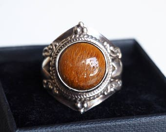 Pretty Nepalese ornamental 925 sterling silver ring and Tiger eye.