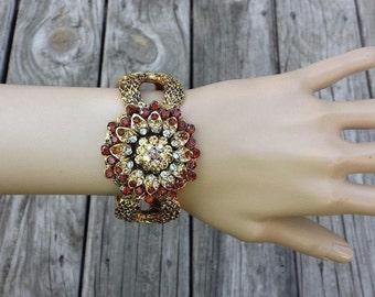 Flower Designed Gold Tone Textured Hinged Rhinestones Vintage Bracelet, Warm Brown Colors