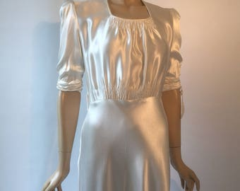 Vintage Art Deco wedding dress in rich satin with ruched details and bias cut skirt