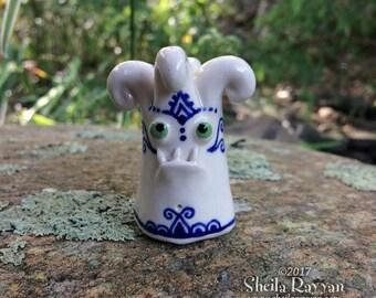 Grumpy Monster - hand sculpted porcelain ceramic buddy desk pet curly