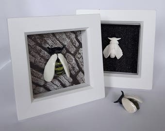 Handmade Ceramic Wasp sat in a simple white box frame