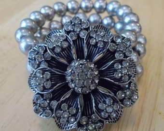 3 Row Gray Pearled Bead Stretch Cuff Bracelet with a Black and Gray Rhinestone Flower